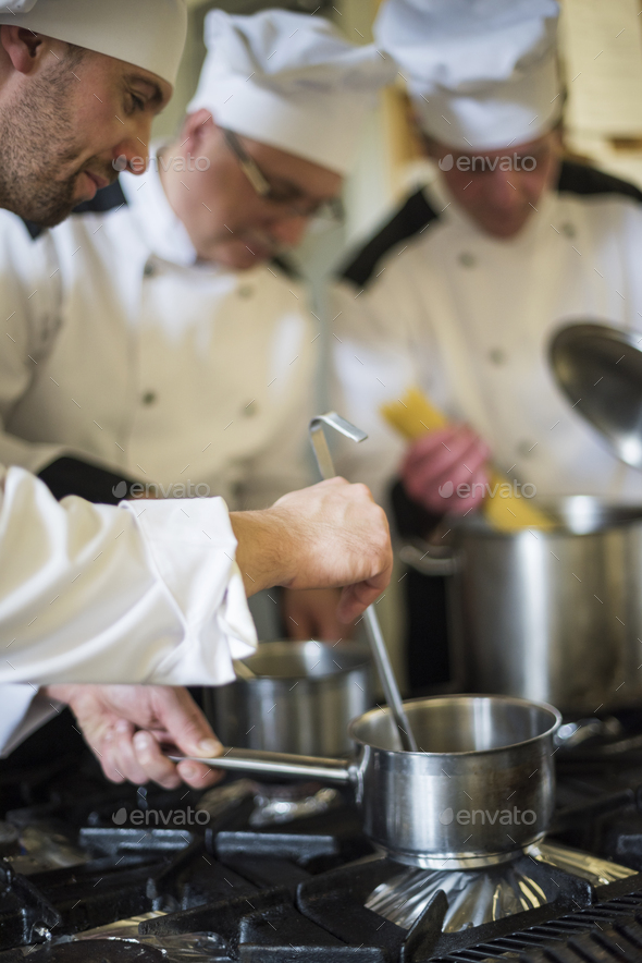 Everyone knows his role in the kitchen - Stock Photo - Images