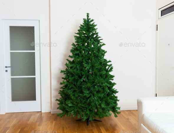 Bare artificial christmas tree - Stock Photo - Images