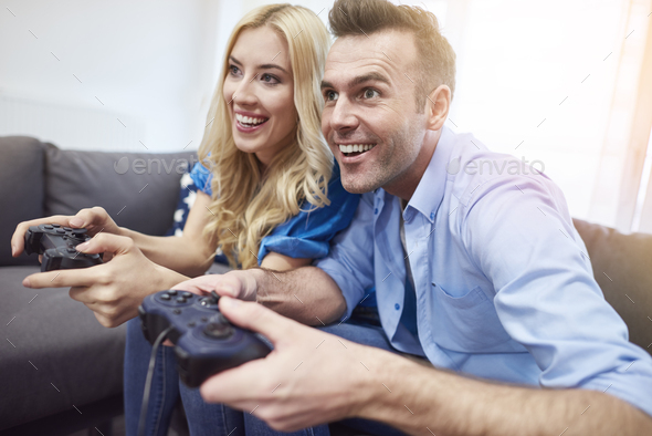 Couple having fun while playing video game - Stock Photo - Images