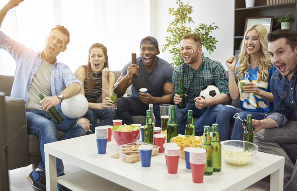 Watching soccer is their common hobby - Stock Photo - Images