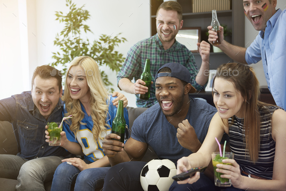 Football fans in the living room - Stock Photo - Images