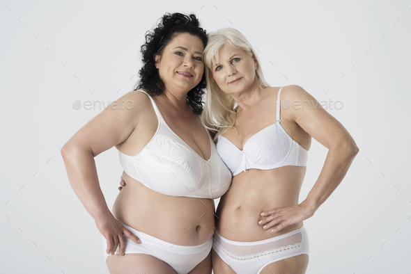 Mature woman standing in underwear - Stock Photo - Images