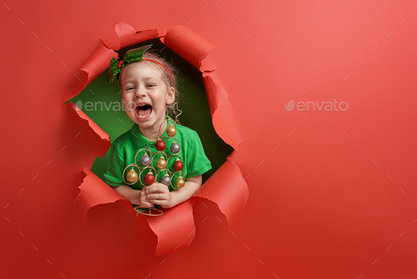 Santa's elf on bright color background - Stock Photo - Images