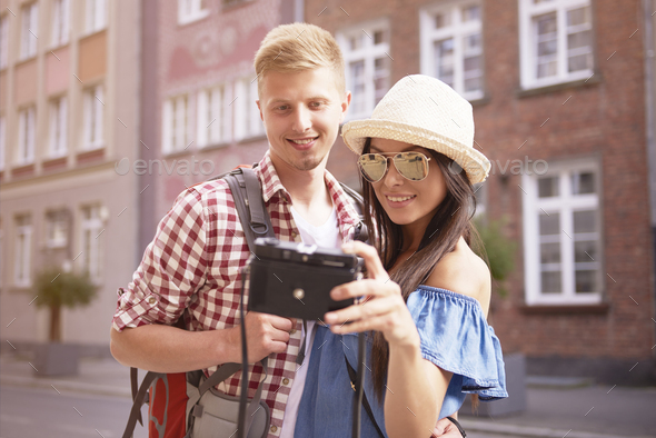 Couple taking self portrait in the city - Stock Photo - Images