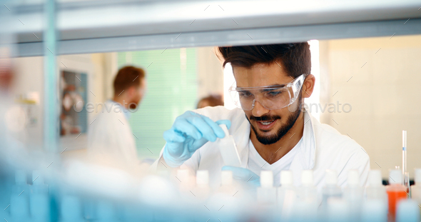 Attractive student of chemistry working in lab - Stock Photo - Images