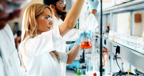 Group of chemistry students working in laboratory - Stock Photo - Images