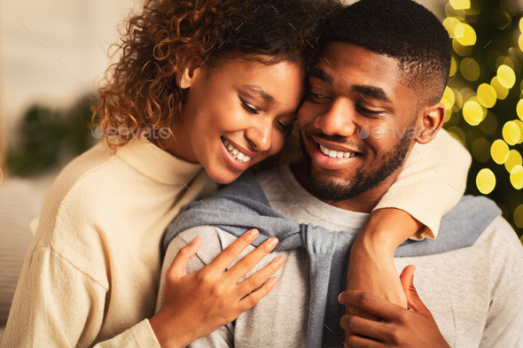 Loving afro couple spending christmas eve together - Stock Photo - Images