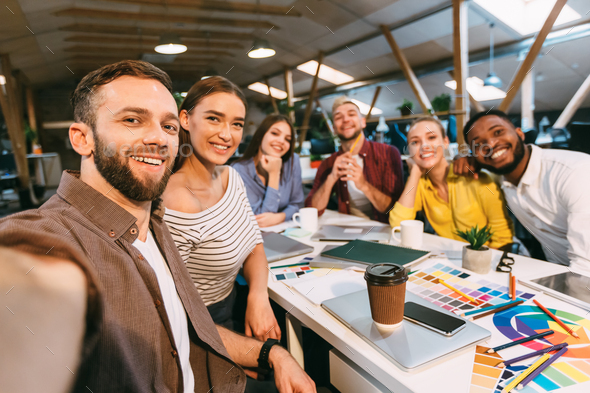 Happy designers making selfie at workplace, working on project - Stock Photo - Images