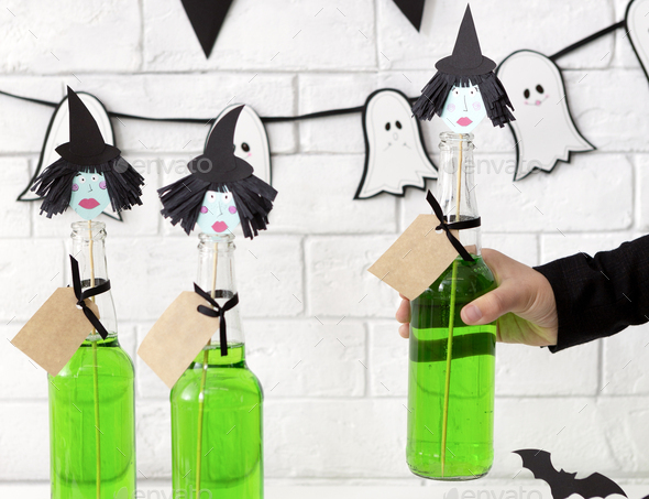Close up of conceptual and creative green Halloween drinks - Stock Photo - Images
