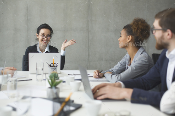 Business people brainstorming together in the meeting room - Stock Photo - Images
