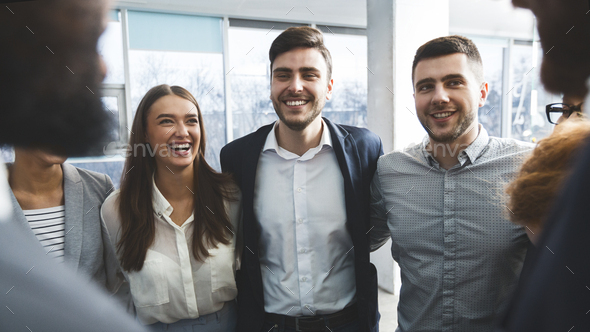 Businesspeople bonding in circle at company seminar - Stock Photo - Images