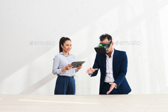 Coworkers testing VR app - Stock Photo - Images