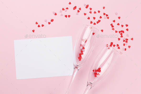 Champagne glasses, greeting card and sweets - Stock Photo - Images