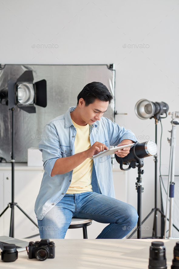 Photographer with digital tablet - Stock Photo - Images