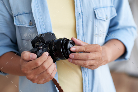 Putting on lens cap - Stock Photo - Images