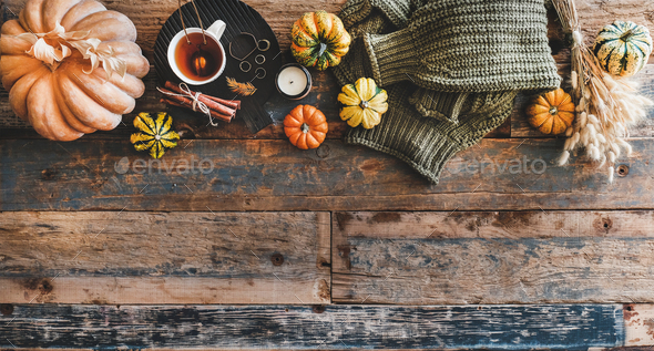 Green sweater and accessories over rustic wooden background, copy space - Stock Photo - Images