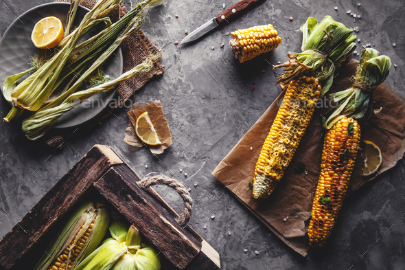 Grilled corn cobs with sauce, coriande. Mexican food. Top view. Copy space, healthy food, vegetables - Stock Photo - Images