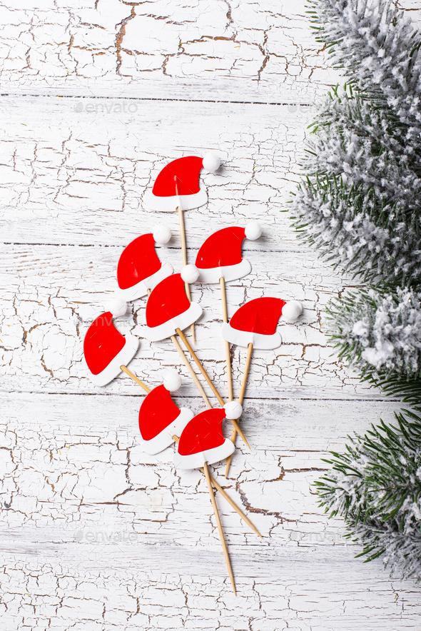 Christmas background with decorative Santa hats - Stock Photo - Images