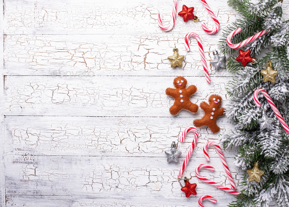 Christmas background with felt gingerbread man - Stock Photo - Images