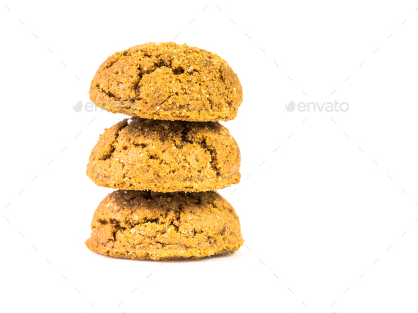 Pile of three traditional pepernoten treats on white background - Stock Photo - Images