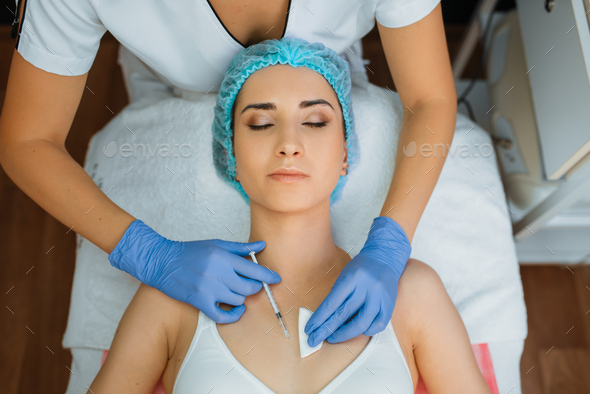 Cosmetician gives botox injection against wrinkles - Stock Photo - Images