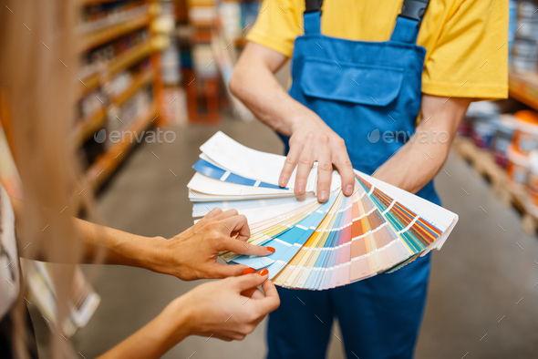 Assistant and customer with color palette, diy - Stock Photo - Images