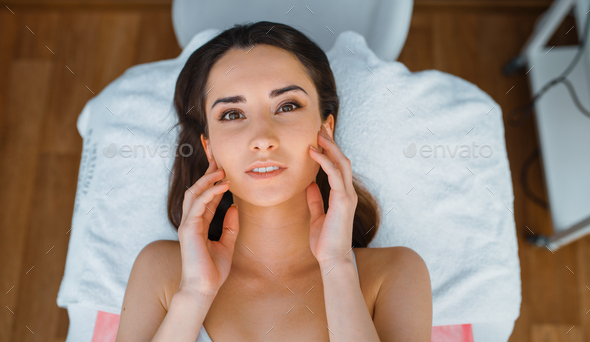 Patient on treatment table in cosmetician's office - Stock Photo - Images