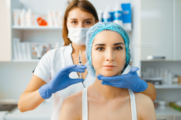 Cosmetician holds syringe with injection of botox - Stock Photo - Images