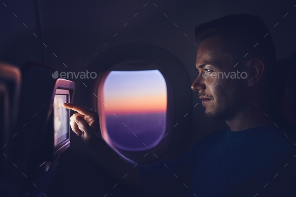 Man travel by airplane - Stock Photo - Images