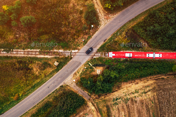 Aerial view of car and train on road junction - Stock Photo - Images