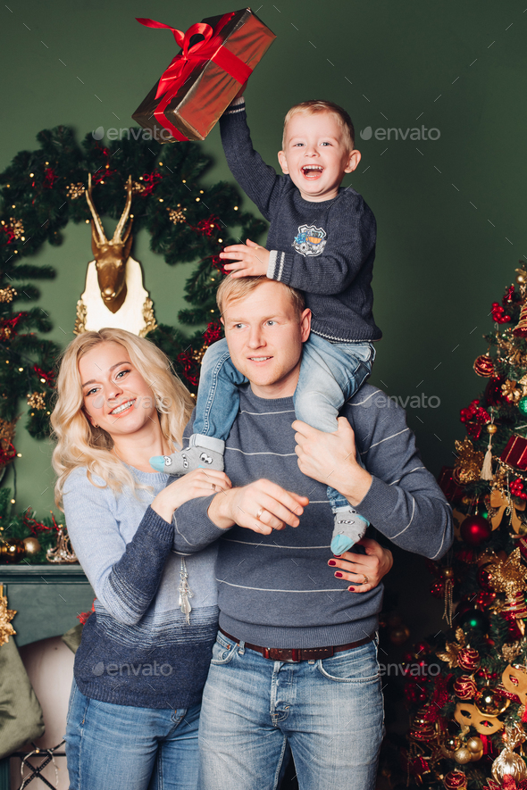 Christmas family photo, dad, son and mom - Stock Photo - Images