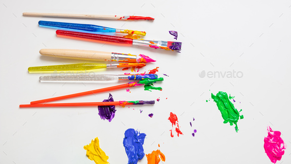 Colorful finger paints on white color background, top view - Stock Photo - Images