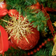 Red Christmas ball hanging on Christmas tree. - PhotoDune Item for Sale