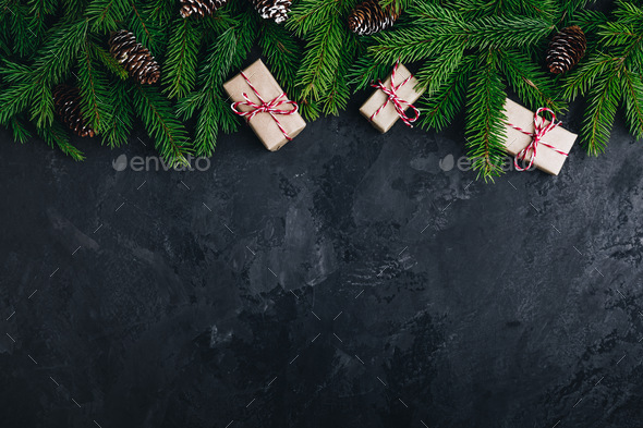 Christmas festive background with christmas tree branches, fir cones and gift boxes - Stock Photo - Images