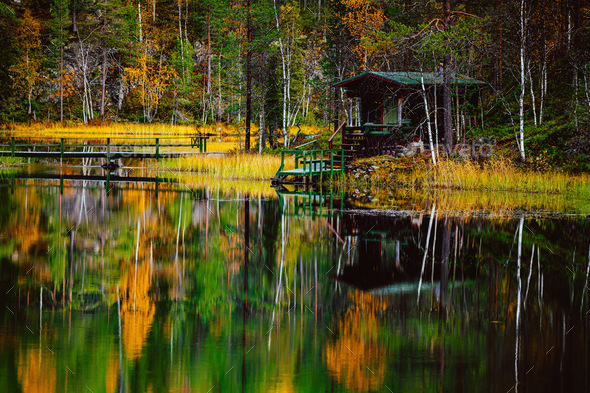 Autumn landscape. Fall colors reflection in lake in Finland - Stock Photo - Images