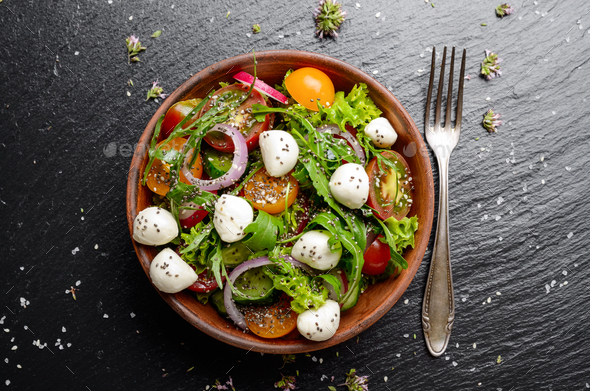 Flat lay of vegetable salad with mozzarella cheese, lettuce, che - Stock Photo - Images