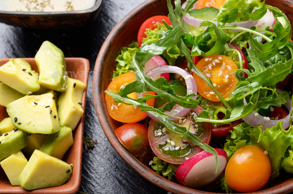 Top view at Clay dish with vegetable salad of lettuce, cherry to - Stock Photo - Images