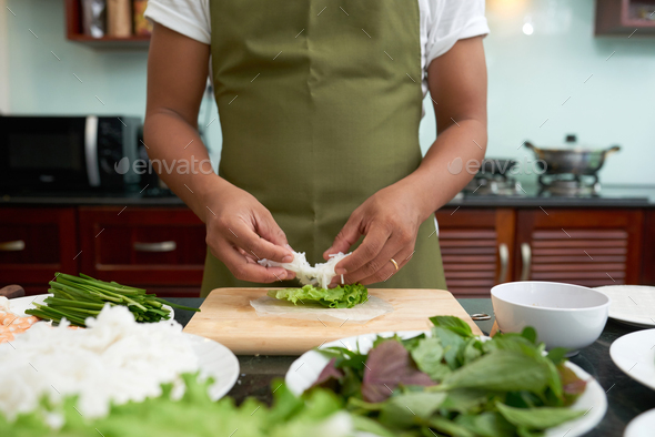 Making spring rolls - Stock Photo - Images