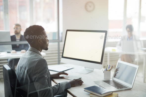 Young African Businessman at Workplace - Stock Photo - Images