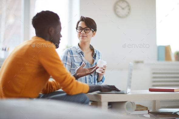 Young Businesspeople Chatting at Coffee Break - Stock Photo - Images