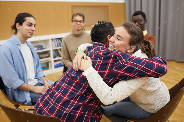 Hugging in Support Group - Stock Photo - Images