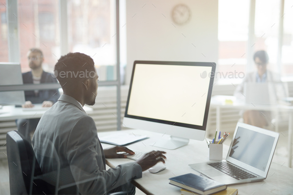 African-American Businessman at Workplace - Stock Photo - Images