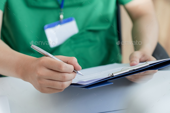 Filling medical history - Stock Photo - Images