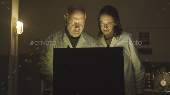 Scientists opening a briefcase in the lab - Stock Photo - Images