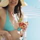 Happy woman at the beach eating a fruit salad - PhotoDune Item for Sale