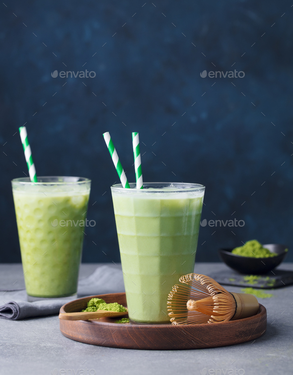 Matcha Green Tea Ice Latte with Matcha Powder and Bamboo Whisk. Grey Background. Copy Space. - Stock Photo - Images