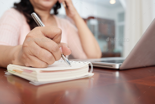 Woman Writing Down Notes - Stock Photo - Images