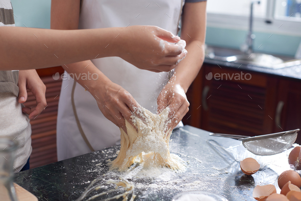 Women Kneading Cookie Dough - Stock Photo - Images