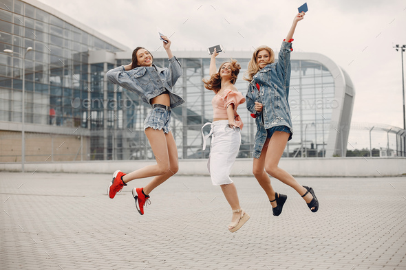 Elegant and stylish girls standing near the airport - Stock Photo - Images
