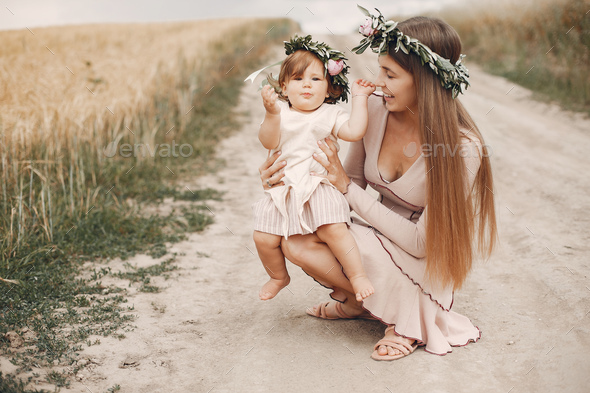 Mother with daughter playing in a summer field - Stock Photo - Images